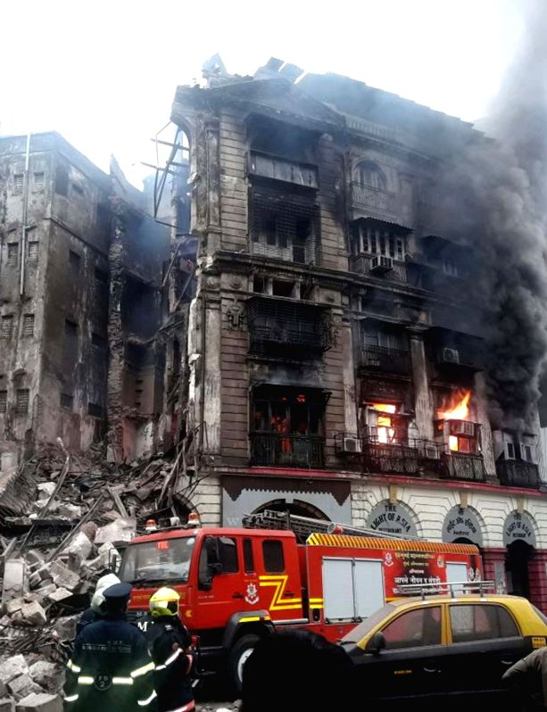 Firefighters at the site where fire broke out in an abandoned five-storeyed building and at least two firemen were injured when a portion of it collapsed, in Mumbai on June 9, 2018. The ...
