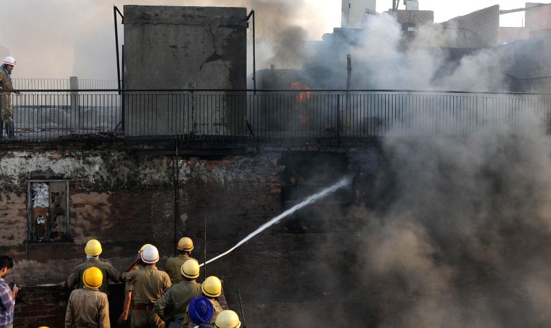 Firefighters busy dousing a fire that broke out in Kinari Bazar of old Delhi's Chandni Chowk area - a wholesale retail market specialising in wedding attire and accessories on Aug 25, 2014.