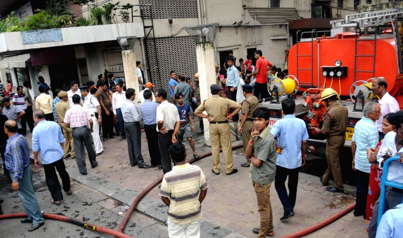 Firefighters try hard to douse a fire that broke out at Jindal House in Kolkata on Aug 12, 2014.