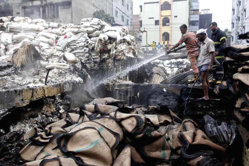 Firefighters try hard to douse a fire that broke out at a chemical warehouse in Swarighat area of Dhaka, Bangladesh on Aug 13, 2014.