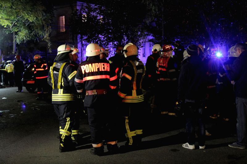 Firemen gather at the nightclub which caught fire in Bucharest, capital city of Romania, Oct. 31, 2015. The nightclub fire late Friday followed by explosions has ...
