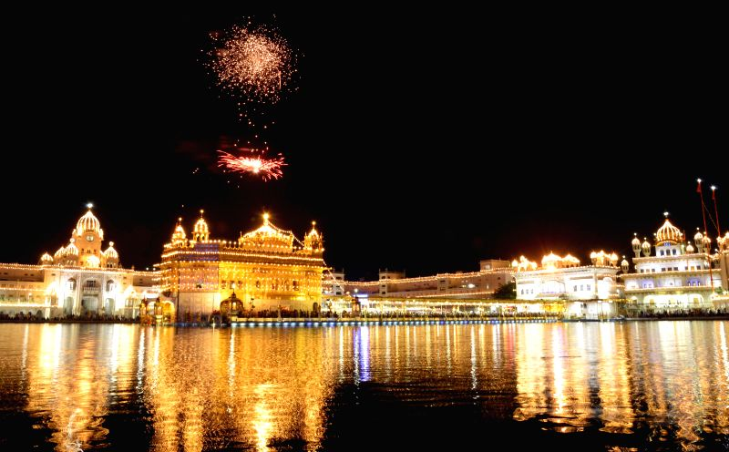 Fireworks at Golden Temple to mark the Birth Anniversary of Guru Hargobind Singh Ji at Golden Temple in Amritsar on July 5, 2014.