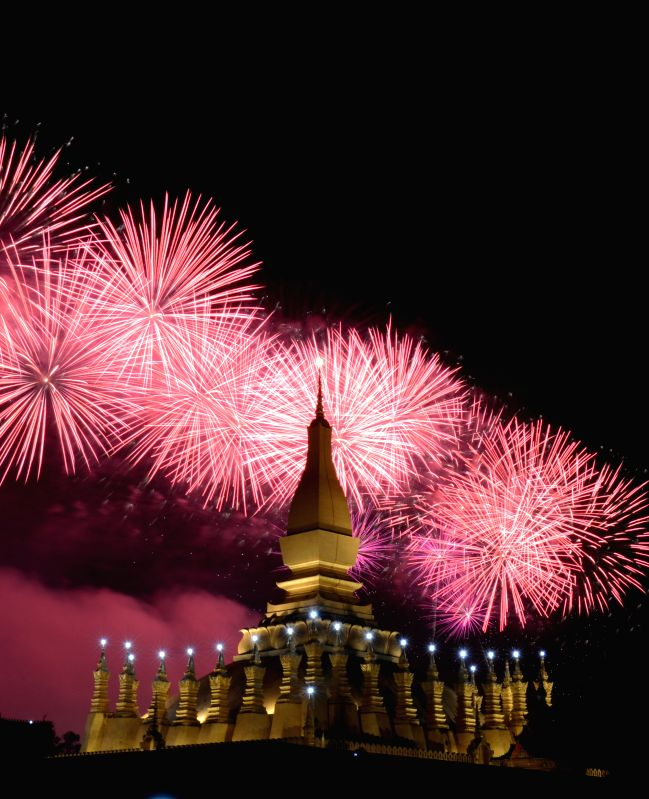 Fireworks explode over the Pha That Luang Square in Vientiane Dec. 2, 2015 in celebration of the 40th anniversary of the founding of the People's Democratic ...