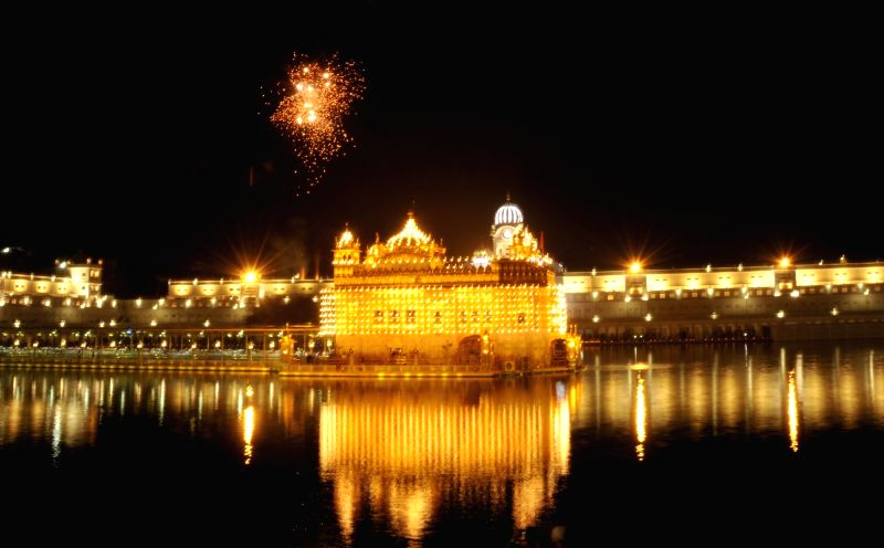 Fireworks light the sky above the Golden Temple on Gur Gadi Diwas in Amritsar, on May 19, 2017.