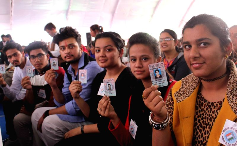 First time voters show their voter identity card
