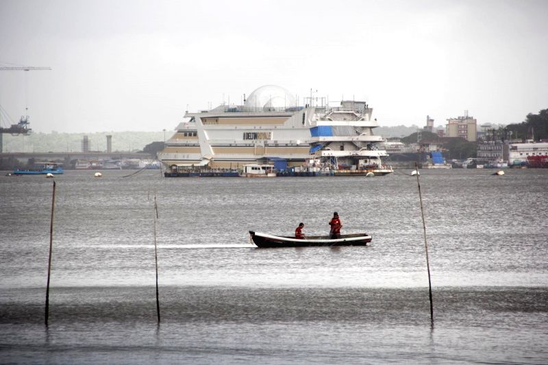 Fisherman engage in fishing activity in the Mandovi river in Verem, Goa on July 26, 2017.