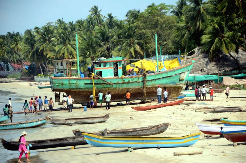Fisherman repair their boat at Malvan sea beach in Sindhudurg district of Maharashtra on May 28, 2017.