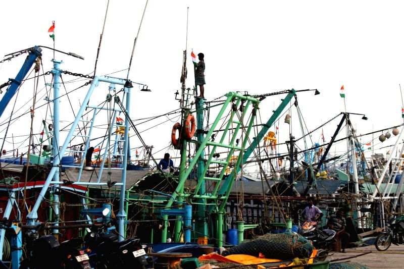 Fishermen busy readying fishing material at a fishing harbor as the 61-day annual ban on fishing will be lifted, in Chennai on June 14, 2018.