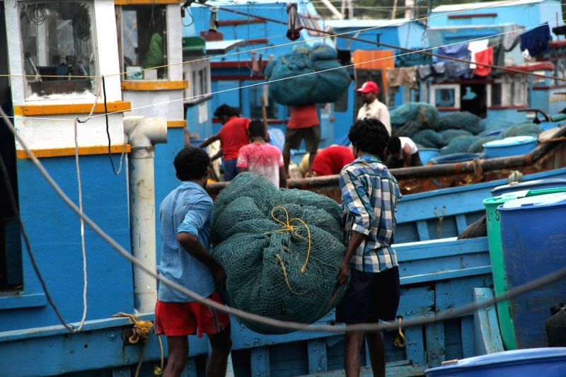 Fishermen load nets and other fishing items into their trawlers at Malim Jetty as the fishing ban will end from 1st August in Goa on July 29, 2016.