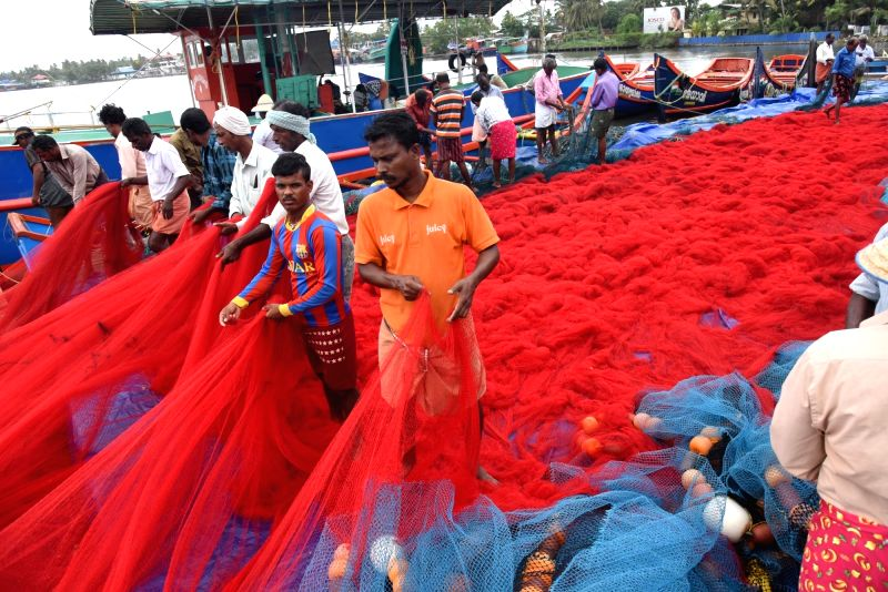 Fishermen pack fishing material ahead of the annual monsoon trawling ban in Kerala that will begin at midnight on June 10 and will be in force for 52 days; at Vyppen harbour in Kochi on June ...