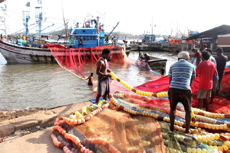 Fishermen unload fishing nets from their boats at Malim Jetty as 61-day long ban on mechanized fishing comes into force from June 1; on May 30, 2016.