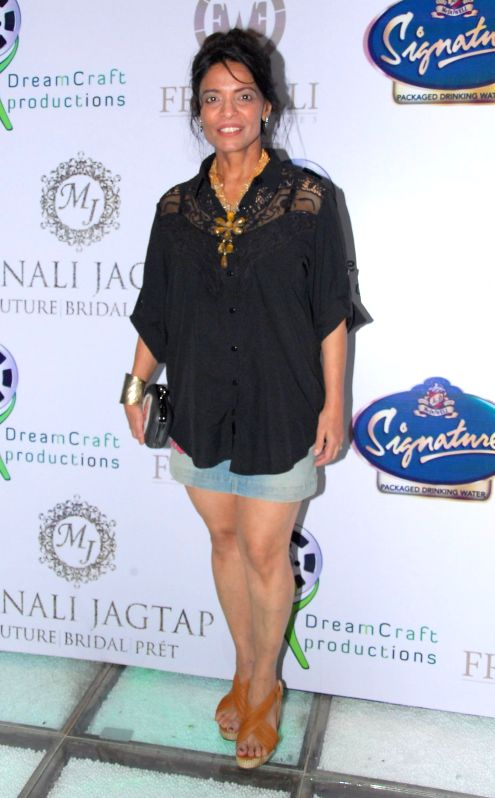 Fitness trainer Leena Mogre during the launch of Manali Jagtap's new `Clutch Closet` bridal handbag collection preview event in Mumbai on July 11, 2014.