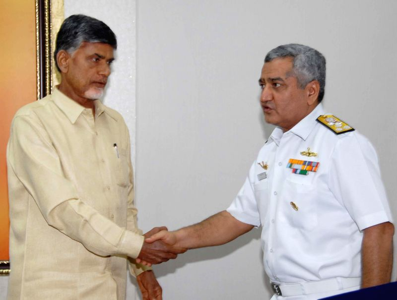 Flag Officer Commanding-in-Chief Eastern Naval Command Vice Admiral Satish Soni calls on Andhra Pradesh Chief Minister N. Chandrababu Naidu in Hyderabad on July 21, 2014. - N. Chandrababu Naidu