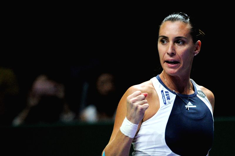 Flavia Pennetta of Italy reacts during the WTA Finals match against Maria Sharapova of Russia in Singapore, Oct. 29, 2015. Sharapova won 2-0. (Xinhua/Then Chih ...