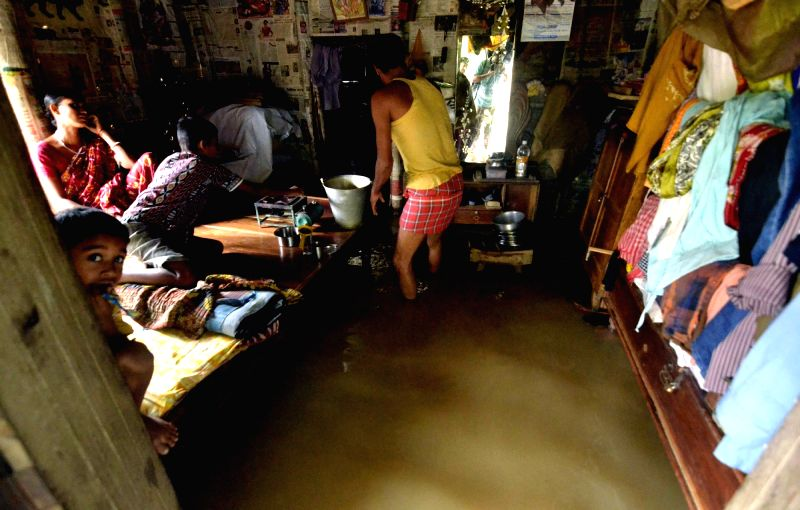 Flood water enters a house in Dharmanagar of Tripura after incessant rains in the region on May 18, 2016.