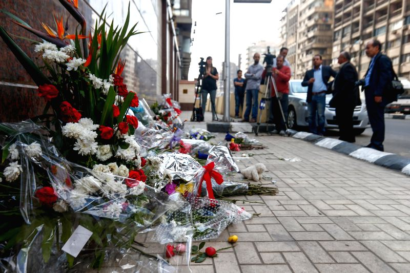 Floral tributes are placed outside the Russian embassy in Cairo on Nov. 2, 2015. Some 144 victims' bodies in a Russian airliner crash in Egypt were transferred to the ...