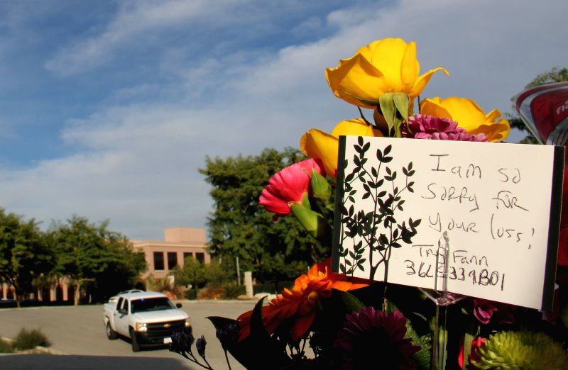 Flowers and a note of mourning for victims are placed at the Inland Regional Center, the site of the mass shooting, in San Bernardino City of Southern ...