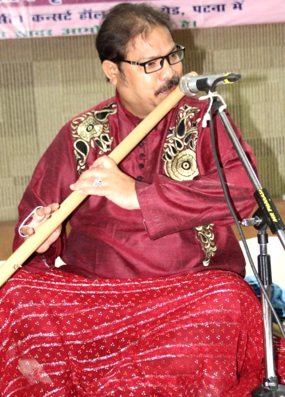 Flutist Ustad Mujtaba Hussain performs during a programme in Patna on July 17, 2016.