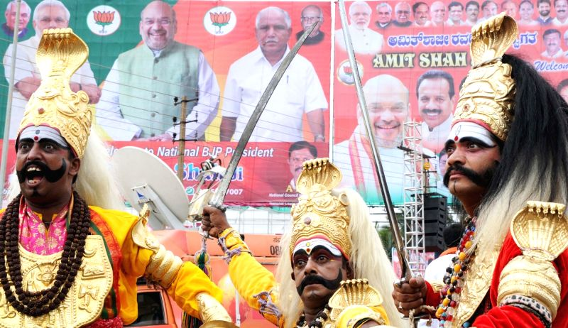 Folk artists perform to welcome BJP President Amit Shah on his arrival in Bengaluru on Aug 12, 2017. - Amit Shah