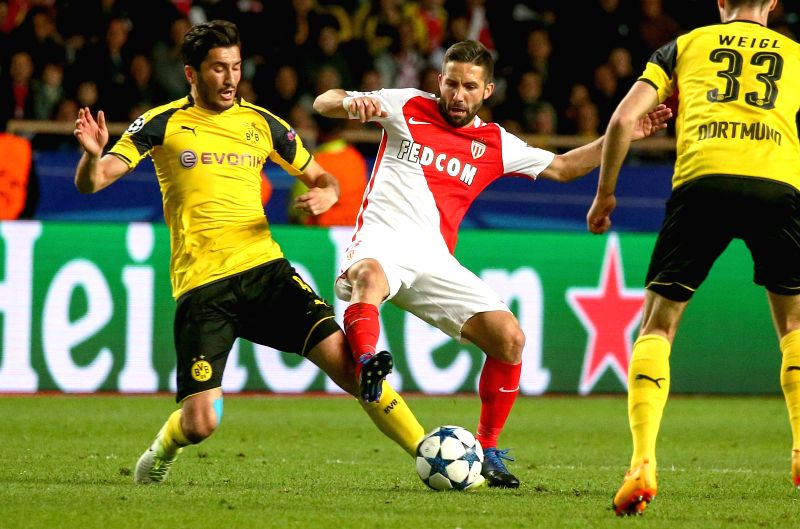 FONTVIEILLE, April 20, 2017 - Joao Moutinho(C) of AS Monaco vies with Nuri Sahin(L) of Borussia Dortmund during their quaterfinal second leg match of UEFA Champions League in Fontvieille, Monaco on ...