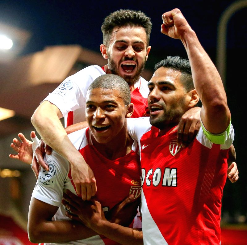 FONTVIEILLE, May 18, 2017 - Kylian Mbappe (L) of AS Monaco celebrates scoring with teammates Radamel Falcao (R) and Bernardo Silva during their match against St-Etienne of French Ligue 1 in ...
