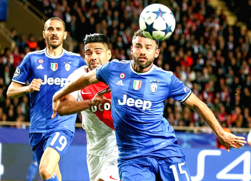 FONTVIEILLE, May 4, 2017 - Radamel Falcao (C) from Monaco competes with Andrea Barzagli (R) from Juventus during the semifinal first leg match of UEFA Champions League in Fontvieille, Monaco on May ...