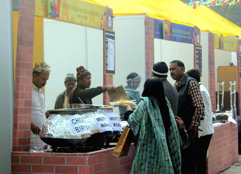 Food stalls setup at 'Dilli Ke Pakwaan -2014' – a street food festival organised at Baba Kharak Singh Marg in New Delhi, on Dec 24, 2014. - Kharak Singh Marg
