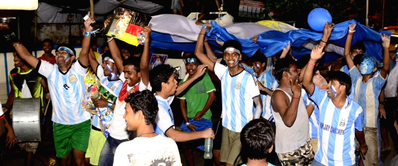 Football fans celebrate in Kolkata after FIFA World Cup 2014 concluded on July 14, 2014.