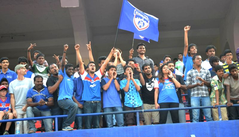 Football fans cheer during a programme organised to celebrate the victory of Bengaluru FC in I League Champions Trophy at Bangalore Football Stadium, in Bangalore on April 29, 2014.