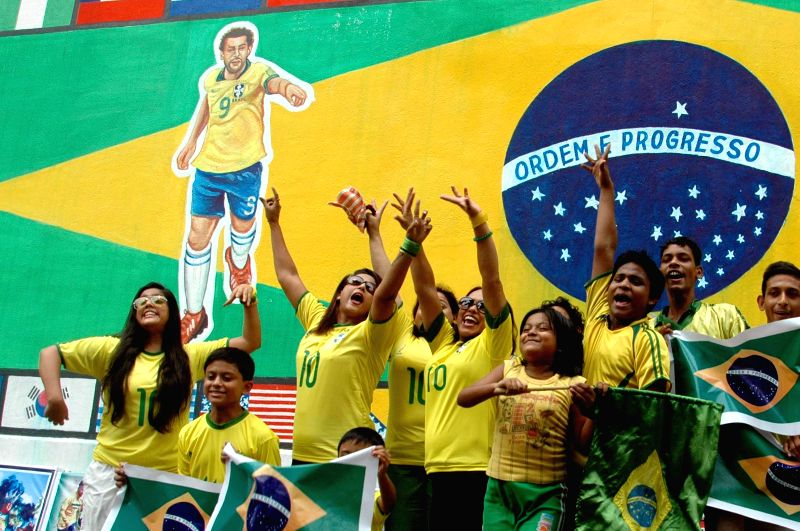 Football fans cheer for Brazil in Kolkata on June 22, 2014.