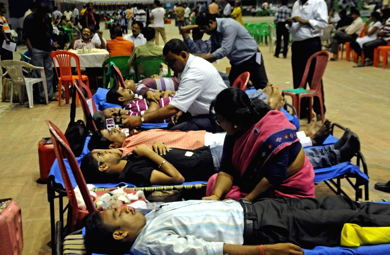 Football lovers donated blood during Football Lovers Day in Kolkata on Aug 16, 2014.