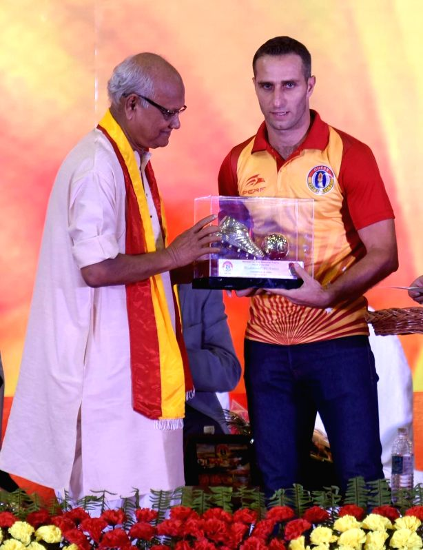 Footballer Mahmoud Amnah being conferred player of the year award during 99th Foundation Day celebrations of East Bengal Football Club in Kolkata, on Aug 1, 2018.