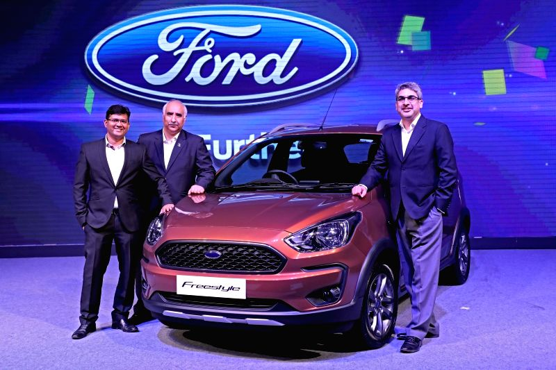 Ford India President and MD Anurag Mehrotra, Executive Director-Marketing, Sales and Service Vinay Raina and Vice President Marketing Rahul Gautam unveil the new Ford Freestyle Compact ... - Rahul Gautam