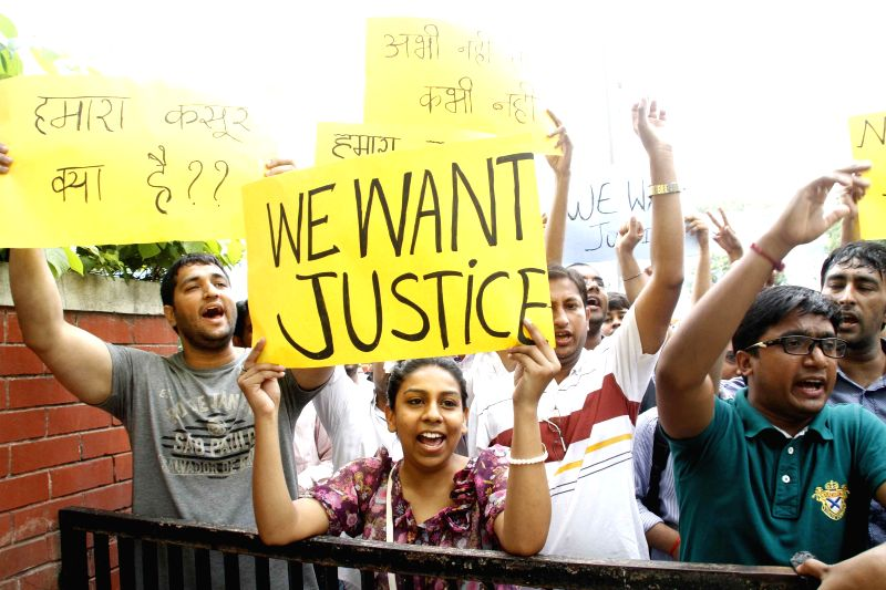 Foreign medical graduates stage a demonstration in New Delhi on Aug 5, 2014.