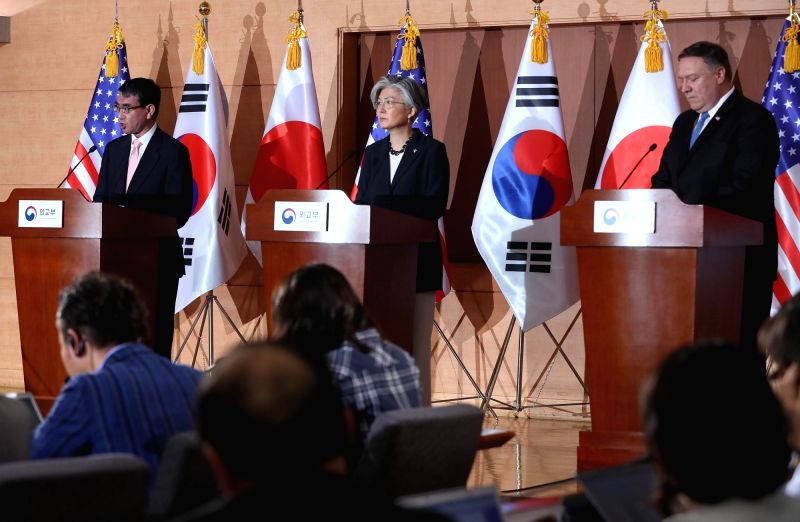 Foreign Minister Kang Kyung-wha (C) attends a joint news conference at the Foreign Ministry in Seoul on June 14, 2018, together with U.S. Secretary of State Mike Pompeo (R) and Japanese ... - Kang Kyung