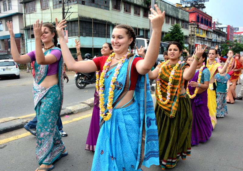 Foreigners participate in a `rath yatra` (chariot procession) taken out by the ISKCON (International Society for Krishna Consciousness) in Guwahati on June 29, 2014.