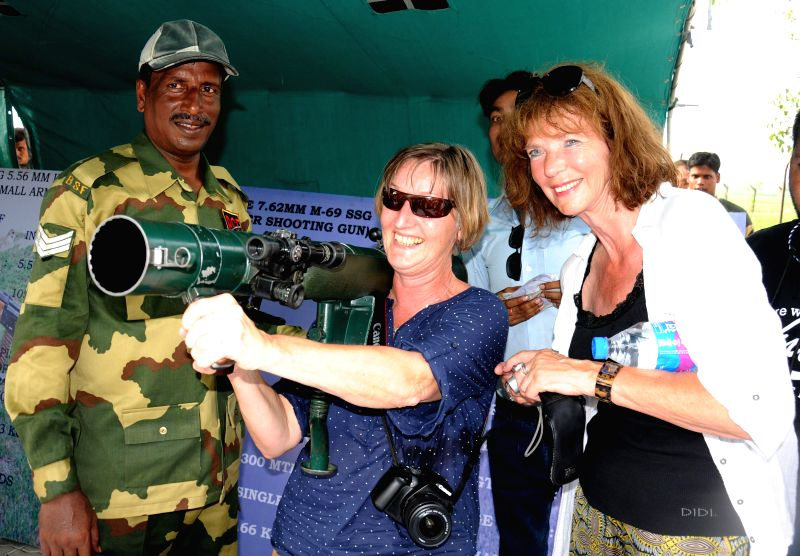 Foreigners visit an arms exhibition organised by BSF at Attari land border (Indo Pakistan border), Punjab ahead of Independence Day on Aug 13, 2014.