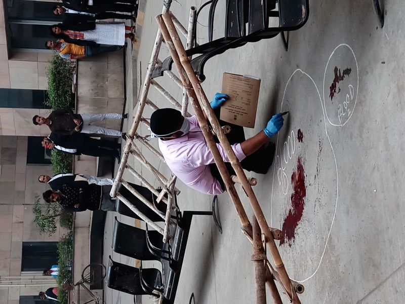 Forensic experts collect samples from the spot where an undertrial Vinod alias Balle was shot dead when he was being taken back from the Rohini court in New Delhi on Nov 13, 2017. ... - Abdul Khan