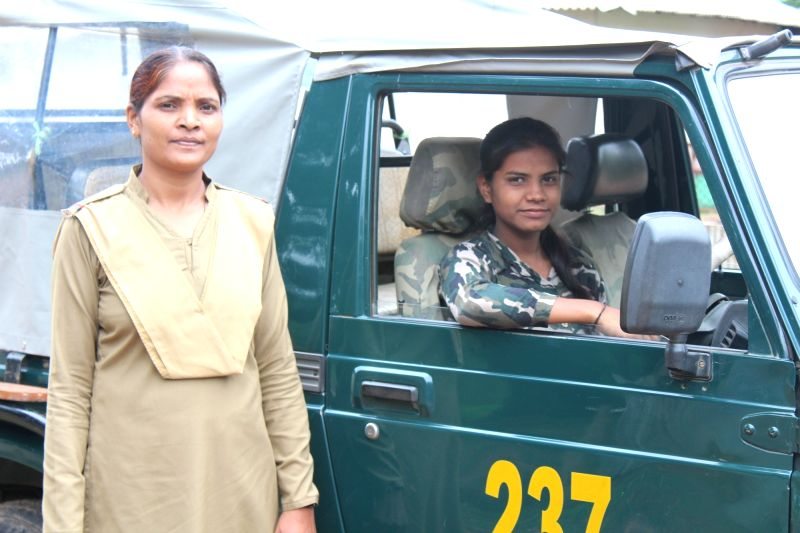 Forest guard Laxmi Meravi (standing) says it's normal to go on night foot-patrolling in the core forest reserve.