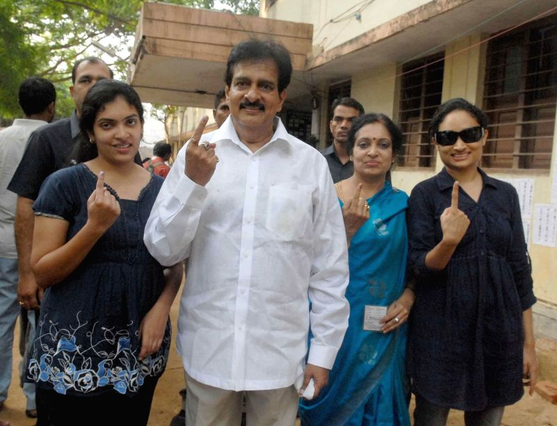 Former Andhra Pradesh DGP V. Dinesh Reddy shows his fore finger marked with phosphorous ink after casting his vote at a polling booth in Hyderabad on April 30, 2014.