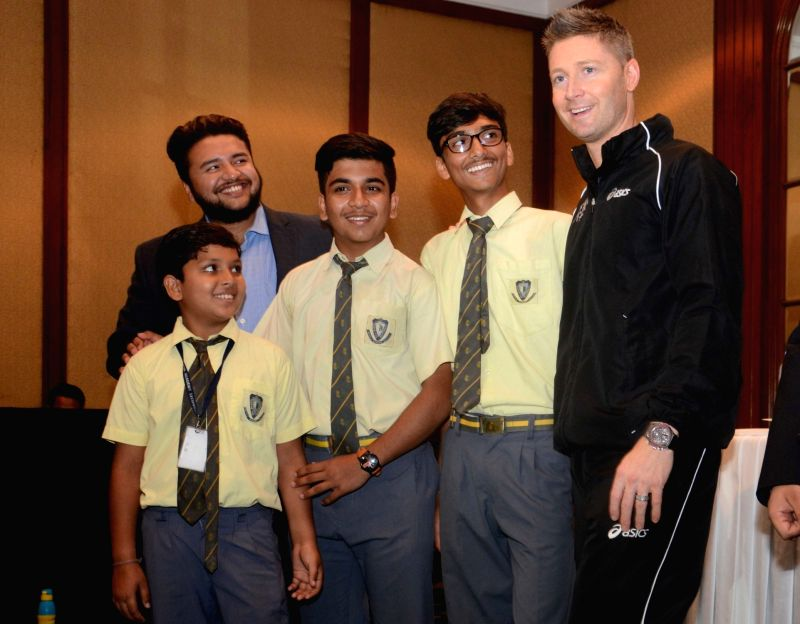 Former Australia cricketer Michael Clarke interacts with students during a press conference in Kolkata on May 13, 2017.