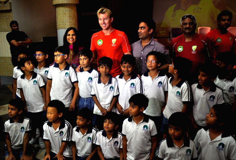 Former Australian cricketer Brett Lee with students during a programme in Jaipur on July 28, 2014.