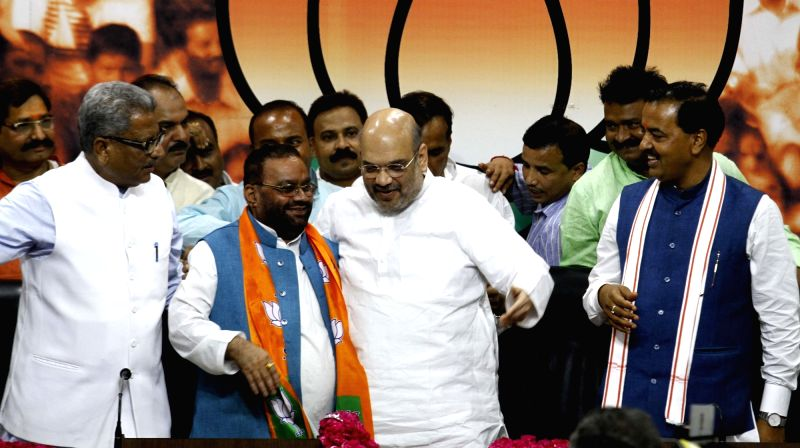Former Bahujan Samaj Party (BSP) leader Swamy Prasad Maurya joins the BJP in the presence of party national president Amit Shah in New Delhi on Aug 8, 2016. - Amit Shah