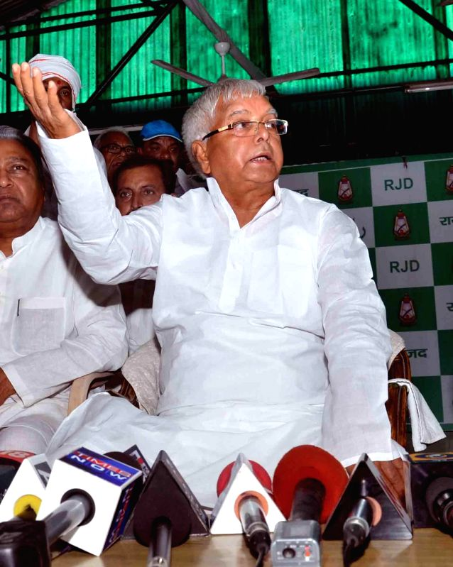 Former Bihar Chief Minister and RJD chief Lalu Prasad Yadav addresses a press conference regarding his party's performance in Patna on May 16, 2014. - Lalu Prasad Yadav