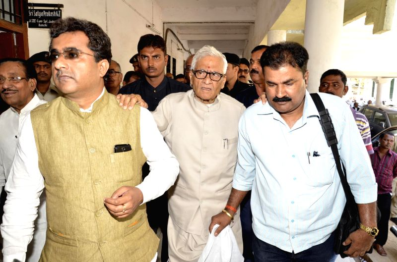 Former Bihar Chief Minister Jagannath Mishra arrives to surrender himself at special CBI court in Ranchi on March 19, 2014. A CBI court convicted Mishra in a multi-crore rupee fodder scam case last ...