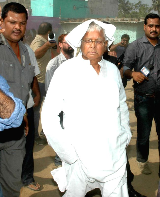 Former Bihar Chief Minister Lalu Prasad Yadav arrives to cast his vote during the fifth phase of 2014 Lok Sabha Polls in Patna on April 17, 2014.