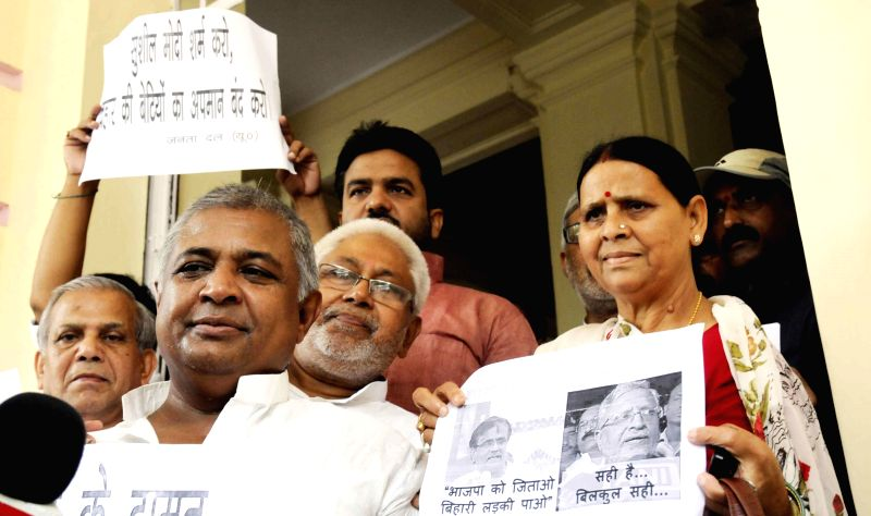 Former Bihar chief minister Rabri Devi participates in a demonstration against BJP's National Kisan Morcha president, OP Dhankar's remarks on Bihari women at Bihar Legislative Council in Patna on ...