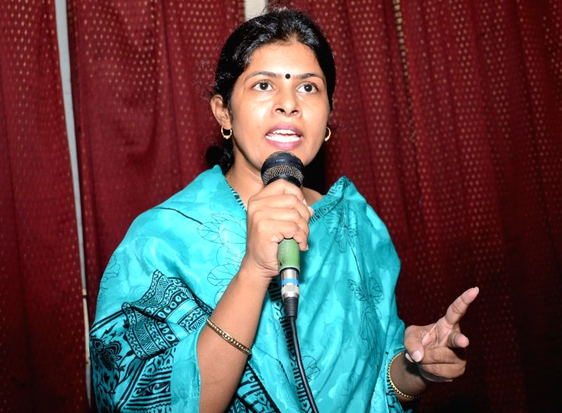 Former BJP leader Dayashankar Singh's wife Swati Singh addresses a press conference in Lucknow on Aug 3, 2016. - Dayashankar Singh and Swati Singh