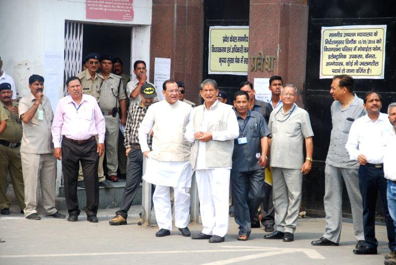 Former Chief Minister Harish Rawat with Congress Party MLAs at the assembly in Dehradun on May 10, 2016. - Harish Rawat