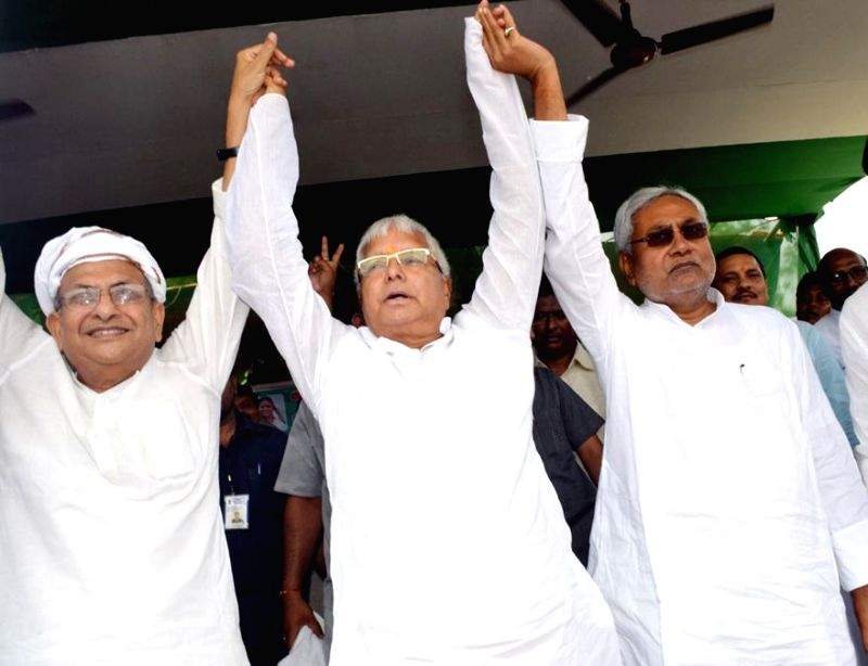 Former Chief Ministers of Bihar, RJD chief Lalu Prasad Yadav and JD-U leader Nitish Kumar during a rally in Hajipur of Bihar on Aug 11, 2014. - Lalu Prasad Yadav and Nitish Kumar